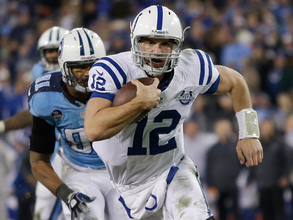 Colts quarterback Andrew Luck (12) scores a touchdown on an 11-yard run as Tennessee Titans defensive end Derrick Morgan (91) chases him during the third quarter of an NFL football game Thursday, Nov. 14, 2013, in Nashville, Tenn. (Wade Payne/AP)