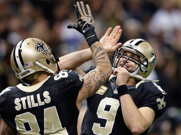 Saints quarterback Drew Brees (9) celebrates with wide receiver Kenny Stills (84) after a touchdown pass in the second half of an NFL football game in New Orleans, Sunday, Nov. 10, 2013. (Dave Martin/AP)