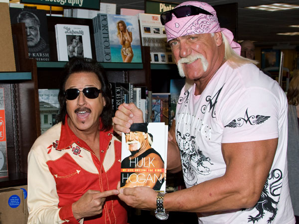 "Jimmy Hart and Hulk Hogan appear at Barnes & Noble to promote his book ""My Life Outside the Ring"" in New York, Tuesday, October 27, 2009. (Charles Sykes/AP file)"
