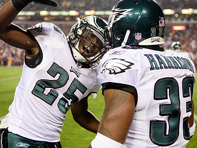 Jerome Harrison is greeted by LeSean McCoy after Harrison´s touchdown run. (Ron Cortes / Staff Photographer)
