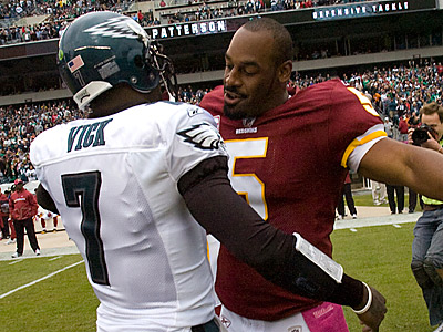 Donovan McNabb embraces Eagles quarterback Michael Vick before last month´s matchup.  (Clem Murray/Staff Photographer)