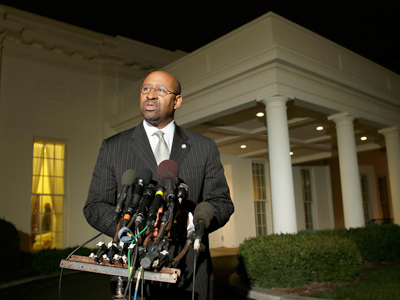 Philadelphia Mayor Michael Nutter speaks to the media outside of the White House, after Vice President Biden met with mayors from cities across the country to talk about taxes and the economy, in Washington on Thursday, Nov. 15, 2012. (AP Photo/Jacquelyn Martin)