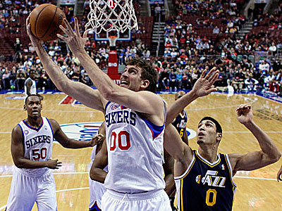 Doug Collins wants to get the Sixers´ big men, including Spencer Hawes, more involved. (Matt Slocum/AP)