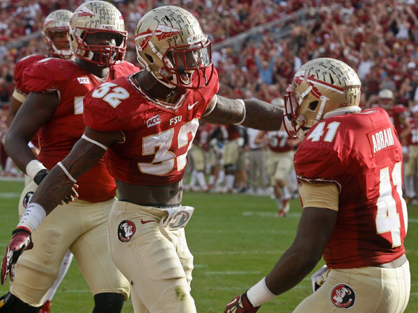 Florida State running back James Wilder Jr. (32) celebrates with fullback Chad Abram (41) after scoring a 3-yard touchdown in the first quarter of an NCAA college football game against Syracuse on Saturday, Nov. 16, 2013, in Tallahassee, Fla. (Phil Sears/AP)