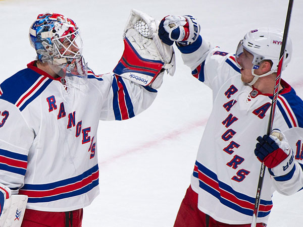 New York Rangers goaltender Cam Talbot, left, celebrates with Marc Staal after the Rangers defeated the Montreal Canadiens in an NHL hockey game Saturday, Nov. 16, 2013, in Montreal. (AP Photo/The Canadian Press, Graham Hughes)