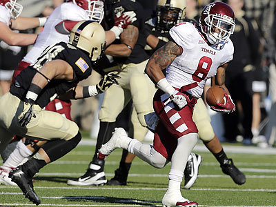 Temple running back Montel Harris (8) runs past the Army defense for a touchdown during the first half of an NCAA college football game Saturday, Nov. 17, 2012, in West Point, N.Y. (AP Photo/Mike Groll)