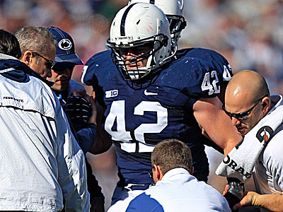 Penn State linebacker Michael Mauti is helped off the field after being injured in the first quarter. (Gene J. Puskar/AP)