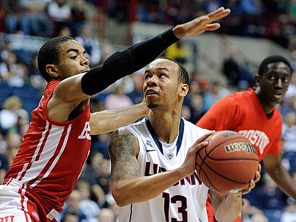 Connecticut´s Shabazz Napier looks to the hoop while being guarded by Boston University´s Maurice Watson Jr. (Fred Beckham/AP)