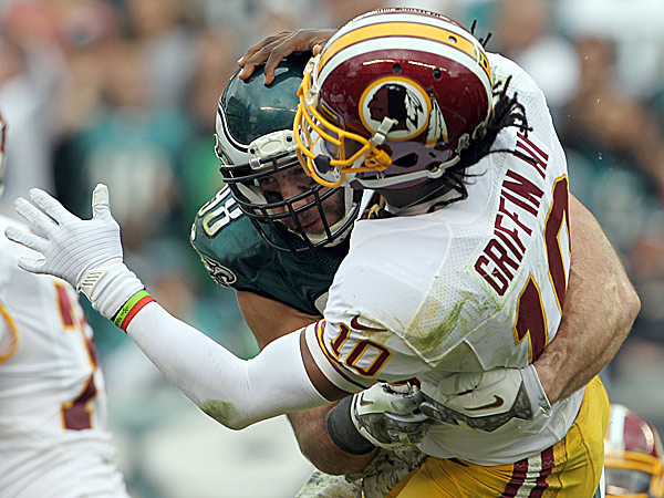 Eagles linebacker Connor Barwin hits Redskins quarterback Robert Griffin III. (Yong Kim/Staff Photographer)