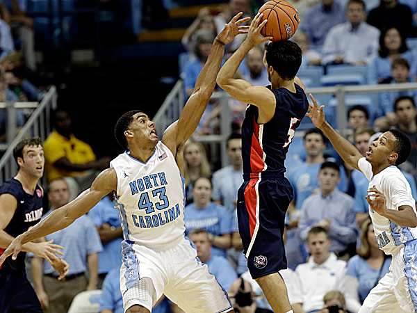 North Carolina´s James Michael McAdoo and Nate Britt defend against Belmont´s Caleb Chowbay. (Gerry Broome/AP)