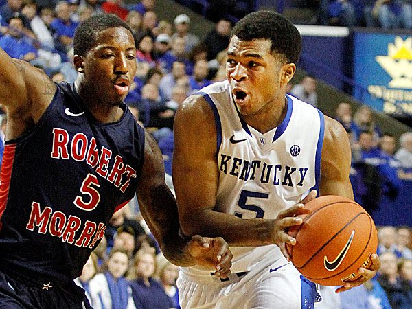 Kentucky´s Andrew Harrison dribbles by Robert Morris´ Anthony Myers-Pate. (James Crisp/AP)