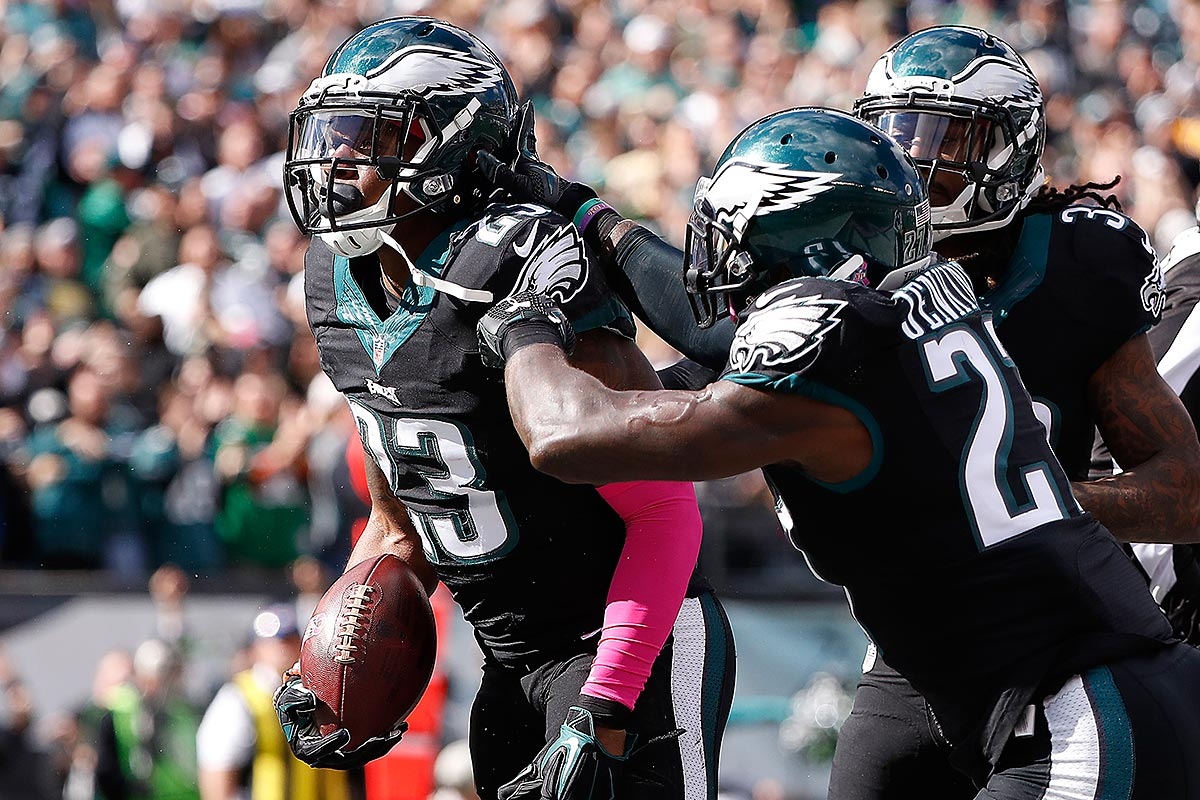 Rodney McLeod (left) celebrates with Malcolm Jenkins (center) and Ron Brooks after an interception against the Vikings.