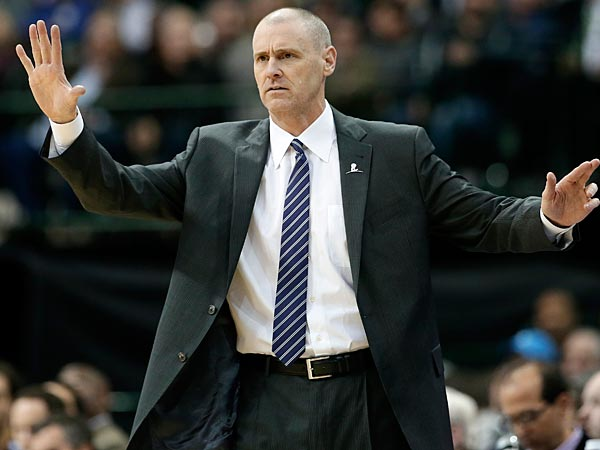 Dallas Mavericks head coach Rick Carlisle instructs his team during an NBA basketball game against the Washington Wizards, Tuesday, Nov. 12, 2013, in Dallas. The Mavericks won 105-95. (AP Photo/Tony Gutierrez)