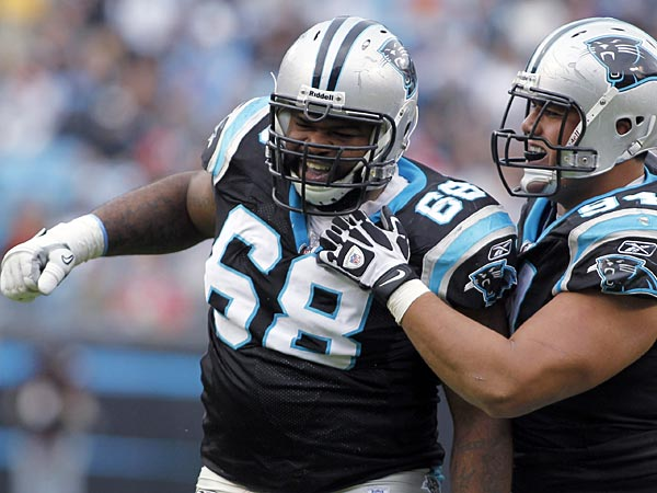 In this Nov. 13, 2011, photo, Carolina Panthers´ Andre Neblett (68) and Sione Fua (94) celebrate a defensive play against the Tennessee Titans during an NFL football game in Charlotte, N.C. The NFL has announced that Neblett has been suspended without pay for the first four games of the regular season for violating the league´s policy on performance enhancing substances. (AP Photo/Bob Leverone)