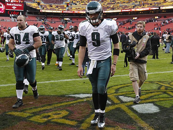 Eagles quarterback Nick Foles, right, walks off the the field after the Philadelphia Eagles lose 31-6 to the Washington Redskins at FedEx<br />Field in Landover, MD, on November 18, 2012. (David Maialetti/Staff Photographer)