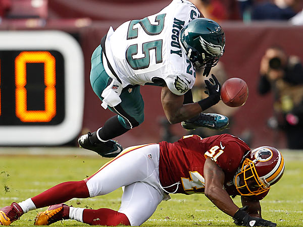 Eagles LeSean McCoy is upended by Redskins Madieu Williams in first quarter. Philadelphia Eagles vs Washington Redskins on Sunday, November 18, 2012.  (Ron Cortes/Staff Photographer)