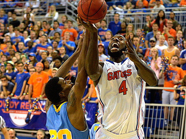 Florida center Patric Young goes to the basket for two points with Southern University forward Calvin Godfrey unable to block the shot. (Phil Sandlin/AP)