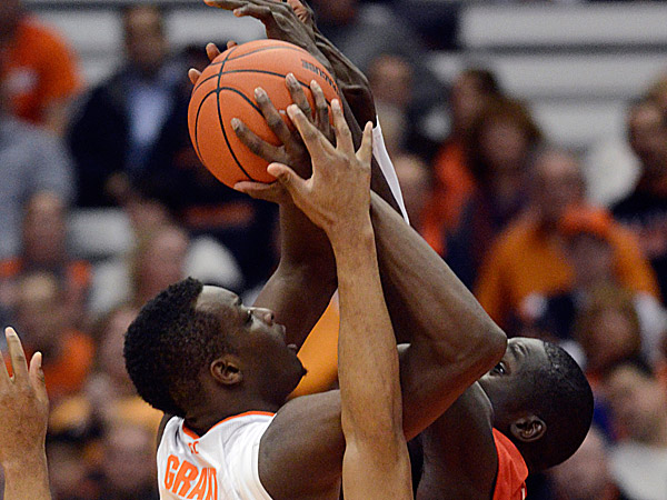 Syracuse´s Jerami Grant drives to the basket against St. Francis´ Andy Fall during the first half. (Kevin Rivoli/AP)