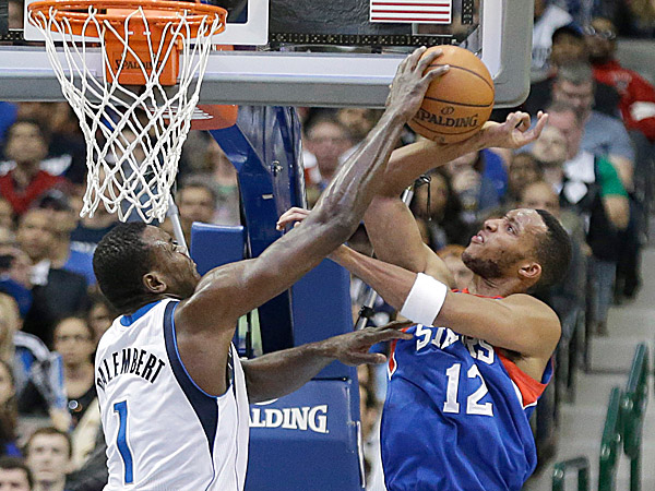 76ers forward Evan Turner has his shot blocked by Mavericks center Samuel Dalembert. (LM Otero/AP)