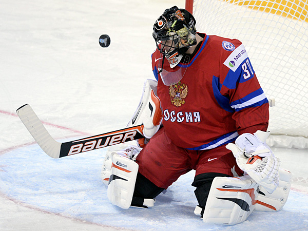 Ilya Bryzgalov saves a shot during international competition. (Martti Kainulainen Lehtikuva/AP)