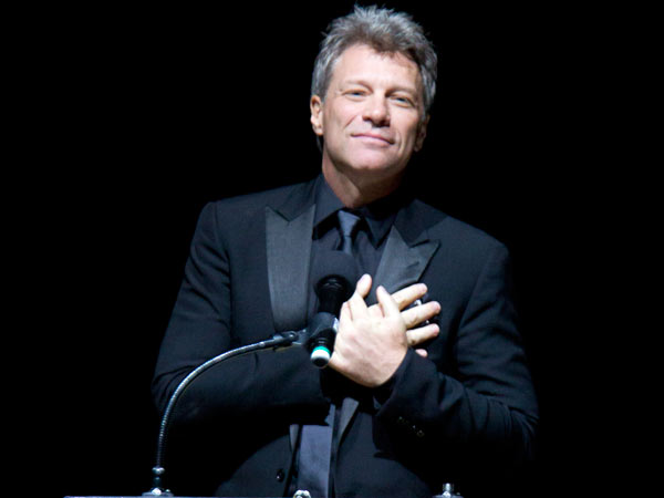 Jon Bon Jovi places his hands over his heart after receiving the Marian Anderson Award on Nov. 18, 2014. ( CHARLES FOX / Staff Photographer )