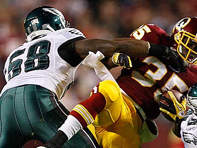 Trent Cole and the Eagles defense face the Giants Sunday night. (David Maialetti/Staff Photographer)