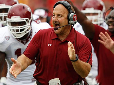 Temple football coach Steve Addazio will not be leaving Temple for Rutgers, sources tell the Inquirer. (Patrick Semansky/AP)