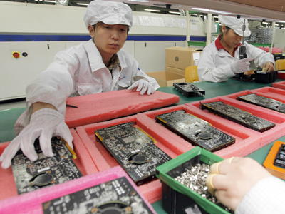 At the Foxxconn complex in Shenzhen, China, workers assemble electronic products, including iPhones. (Kin Cheung / Associated Press, File)