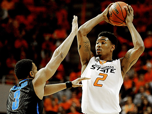 Oklahoma State wing Le´Bryan Nash looks over Memphis guard Chris Crawford. (Brody Schmidt/AP)