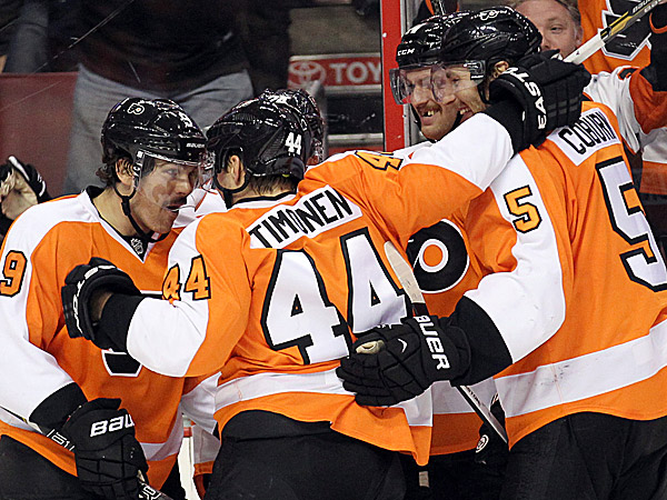 Flyers defenseman Kimmo Timonen celebrates a goal with his teammates. (Yong Kim/Staff Photographer)