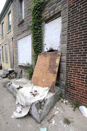 Recklessly abandoned: Philly´s neglected buildings might affect our health in more ways than one. This unoccupied, tax-delinquent home is in the 2300 block of Gerritt Street.  (Photo by Clem Murray)