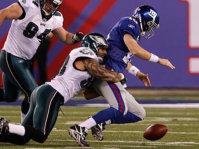 The Eagles hope Jason Babin and the defensive line can pressure Tom Brady. (David Maialetti/Staff Photographer)