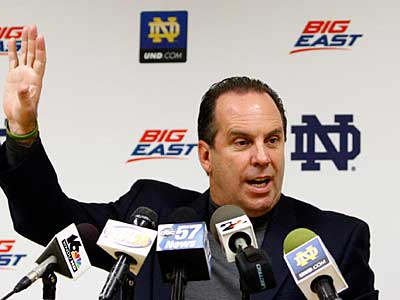 Notre Dame hoops coach Mike Brey knows as well as anyone that football rules the world of college athletics. (AP Photo / Marcus Marter)