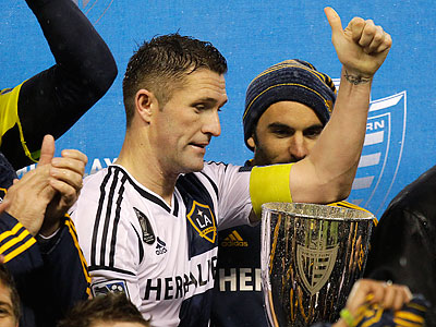 Los Angeles Galaxy forward Robbie Keane celebrates with the Western Conference trophy. (Ted S. Warren/AP)