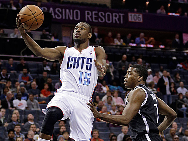 The Bobcats´ Kemba Walker drives past the Nets´ Joe Johnson. (Chuck Burton/AP)