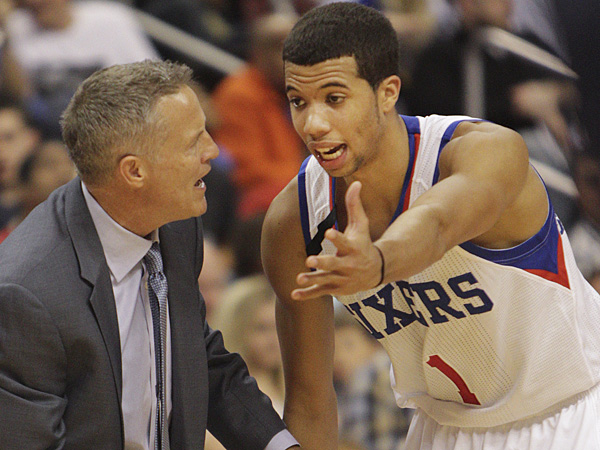 76ers coach Brett Brown talks with rookie point guard Michael Carter-Williams. (Steven M. Falk/Staff Photographer)