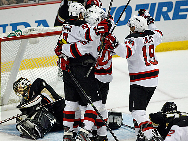 Devils right wing Dainius Zubrus and left wing Patrik Elias celebrate a goal by Devils right wing Jaromir Jagr with Devils center Travis Zajac as Ducks goalie Jonas Hiller lies in the goal mouth. (Alex Gallardo/AP)