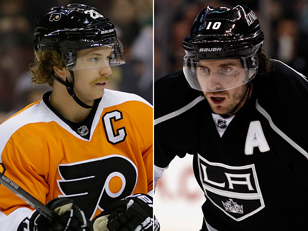 Current Flyers captain Claude Giroux (left) and former Flyers captain Mike Richards (right). (AP Photos)
