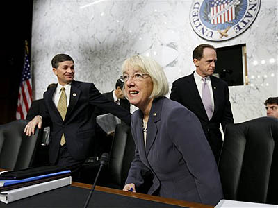 The co-chairs of the Joint Select Committee on Deficit Reduction, Sen. Patty Murray, D-Wash., center, and Rep. Jeb Hensarling, R-Texas, left, arrive on Capitol Hill in Washington, Wednesday, Oct. 26, 2011, for the start of a hearing with Congressional Budget Office (CBO) Director Douglas Elmendorf. Sen. Patrick Toomey, R-Pa., walks at right. (AP Photo/J. Scott Applewhite)
