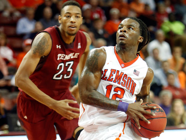 Clemson´s Rod Hall, right, goes in for a layup against Temple´s Devontae Watson in the first half at the Charleston Classic NCAA college basketball tournament in Charleston, S.C., Thursday, Nov. 21, 2013. (Mic Smith/AP)