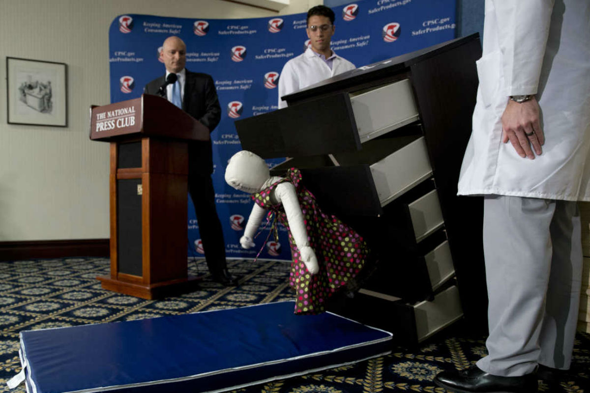 Consumer Product Safety Commission (CPSC) Chairman Elliot Kaye, left, watches a demonstration of how an Ikea dresser can tip and fall on a child during a news conference at the National Press Club in Washington on June 28, 2016.