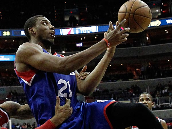 Washington Wizards guard Bradley Beal, left, fouls Philadelphia 76ers forward Thaddeus Young (21) in the first half of an NBA basketball game, Friday, Nov. 1, 2013, in Washington. Young had 29 points, as the 76ers won 109-102. (AP Photo/Alex Brandon)