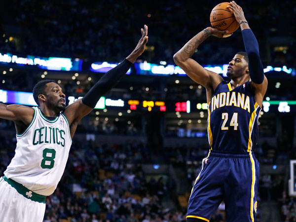 Pacers forward Paul George (24) shoots over Boston Celtics guard Jeff Green (8) during the first quarter of an NBA basketball game, Friday, Nov. 22, 2013, in Boston. (Charles Krupa/AP)