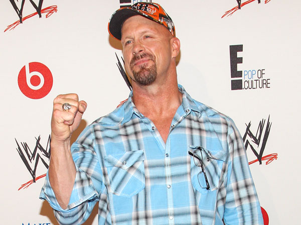 WWE Superstar Stone Cold Steve Austin arrives at the Superstars of Hope honors Make A Wish Foundation event at The Beverly Hills Hotel on Thursday, August 15, 2013 in Beverly Hills, Calif. (Photo by Paul A. Hebert/Invision/AP)