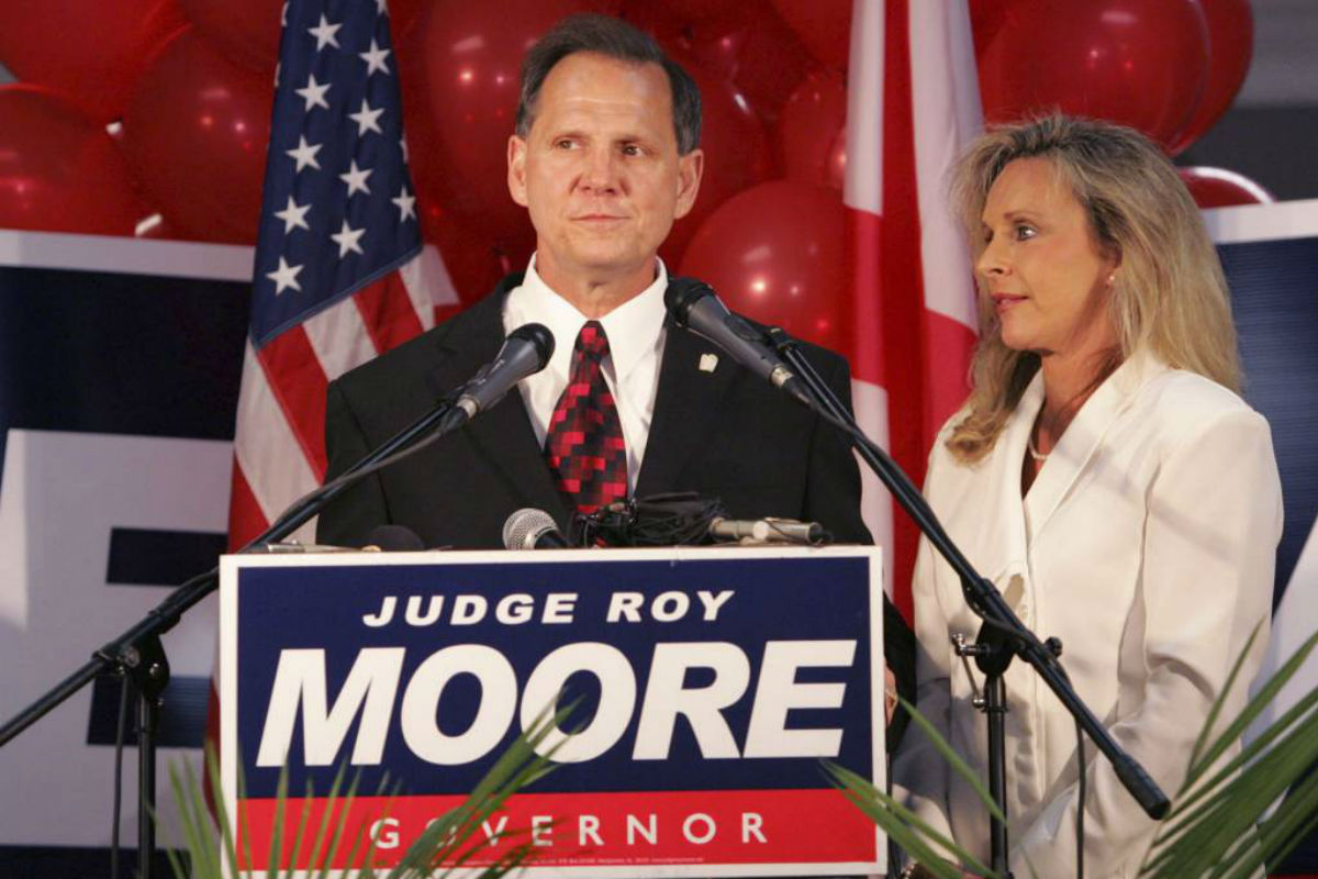 FILE - In this Tuesday, June 6, 2006 file photo, Judge Roy Moore stands with his wife, Kayla.