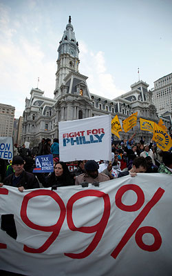 Protesters affiliated with Occupy Philly encampment at City Hall march to the Market Street bridge Thursday, Nov. 17, 2011, in Philadelphia. <br />(AP Photo/Matt Rourke)