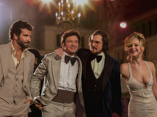 """American Hustle"": (from left) Amy Adams, Bradley Cooper, Jeremy Renner, Christian Bale, and Jennifer Lawrence in David O. Russell´s 1970s crime caper inspired by the Abscam scandal that brought down politicians, including some local ones. Dec. 18."