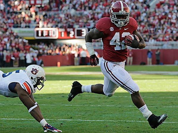 Alabama running back Eddie Lacy (42) scores a touchdown as Auburn defensive end Dee Ford. (Dave Martin/AP)
