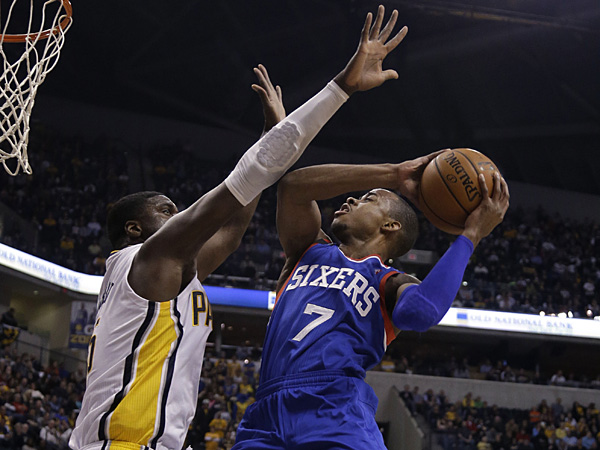Philadelphia 76ers guard Lorenzo Brown, right, shoots over Indiana Pacers center Roy Hibbert during the first half. (AJ Mast/AP)