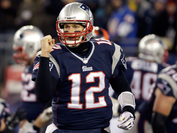 Patriots quarterback Tom Brady celebrates a touchdown against the Denver Broncos in the third quarter of an NFL football game Sunday, Nov. 24, 2013, in Foxborough, Mass. (Stephan Savoia/AP)